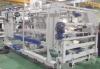 Apilador-contador por encima para mejorar la formación de paquetes sin atascos